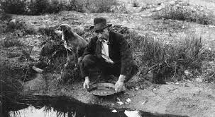 Old time miner panning for gold